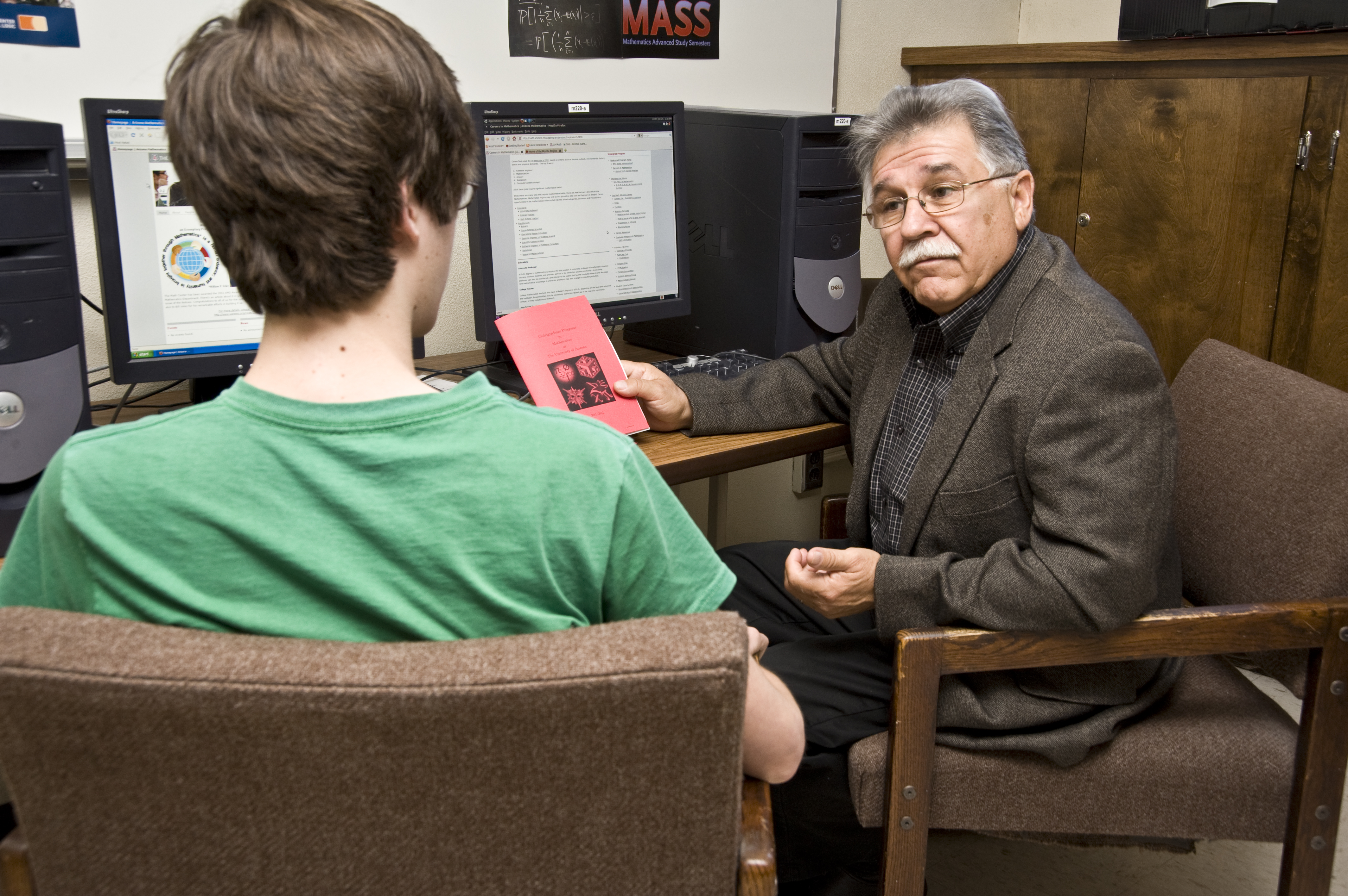 Dr. Velez, Associate Head for Undergraduate Affairs, advising a math major.