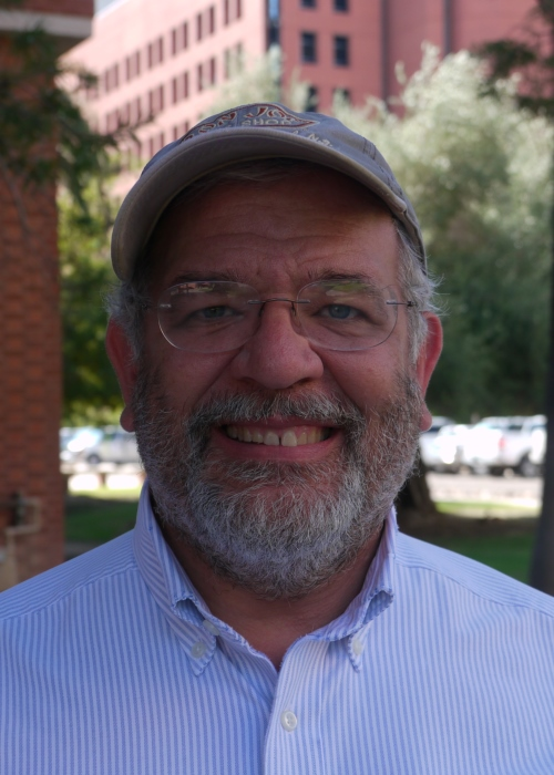 Picture of Robert Indik with facial hair and a hat